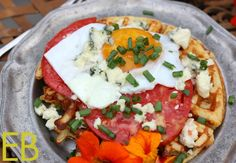 Eggs Paloma {savory Parmesan waffle, topped with sunnyside up egg, heirloom tomato and blue cheese}