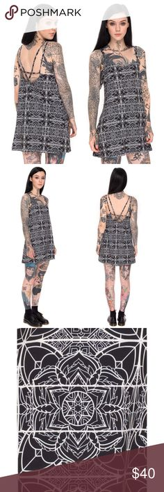 Motel Rocks X Grace Neutral Slip Dress Brand new without tags! Only tried in once and am not sure if I like the fit on me. It's a gorgeous black & white geometric mandala pattern designed by tattoo artist Grace Neutral. 3rd image is a close up of the pattern. Loose fitting. Cute strappy look in the back. Model is wearing a size small. Feel free to ask any questions or make an offer! Motel Rocks Dresses Mini