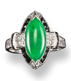 An Art Deco jade and diamond ring, the marquise-shaped jade is set within a surround of square sections of black onyx and diamonds in platinum. With small diamonds set to the foliate engraved shoulders. With inventory number. #ArtDeco #ring