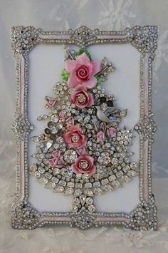 DIY framed art using broaches and vintage jewelry. Wonderful way to display costume heirloom pieces!  Lovely