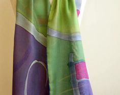 Add some wearable art to your outfit this season!  This is a beautiful double-layer hand painted silk scarf. This unique asbtract design is in blue, green and grey colors.  This will look great on you with any outfit, perfect for everyday wear or an elegant party or wedding.  Size: width: 140 cm = 55 inches height: 22 cm = 5 inches  Materials: Silk: ponge 5.  Washing: I recommend to wash this scarf hand only, although you can use the washing machine with the softest setting. Use sof...