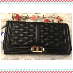 """REBECCA Minkoff Love Clutch  DESCRIPTION Quilted and finished with light gold hardware, this clutch is love at first sight. Use it as a clutch or go crossbody with the optional chain strap.  Color: Black DETAIL & CARE 11""""W x 6""""H x 1.5""""D 23"""" adjustable detachable shoulder strap drop Genuine quilted leather Custom light gold hardware Flap closure with turn lock One exterior slip pocket Seven interior card slip pockets print lining + dust bag.Very Gorgeous and classyPrice Firm unless bundled ‼️…"""