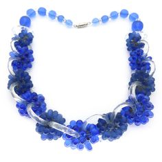 A beautiful Art Deco French necklace. The necklace features blue frosted and smooth beaded clusters linked by cut glass panels. The necklace has...