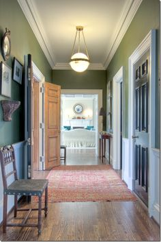 Crown Molding In Hallway. The Dark Doors With White Moldings