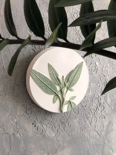 """Green botanical bas relief country house decoration by DinaArtDecor. White small round plate """"Sage"""" wall kitchen decor. Clay art tile farmhouse wall decor. This painted green round panel is perfect if your kitchen, porch or grill house is decorated in a rustic style"""