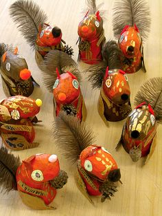 Squirrels! by Fem Manuals!, via Flickr. Looks to be made with paper mache over plastic eggs, cardboard. paint, cut paper and - turkey feathers!