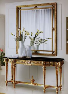 "72"" W X 20"" D X 35"" H Hand carved Louis XVI console in gold leaf finish. Black Marquinia marble top. CAP-285-S Mirror 54""W X 63""H"
