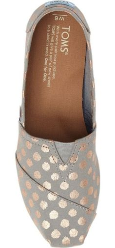 Decorated with shimmery polka dots, these casual, comfortable slip-ons feature TOMS' signature center goring panel and asymmetrical toe cap. https://twitter.com/ShoesEgminfmn/status/895096209521557504
