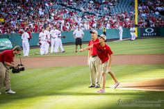 Tom Motherway's  brother and nephew threw out the first pitch as the Los Angeles Angels of Anaheim honored Lou Gehrig with the Orange County Chapter. Image courtesy of Tom Motherway and Gina Chiaramonte photography.