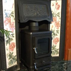 Small stove Looks right Can keep fireplace intact Inset Fireplace, Wood Burner Fireplace, Victorian Fireplace, Small Fireplace, Fireplace Inserts, Fireplace Surrounds, Corner Wood Stove, Mini Wood Stove, Victorian Tiles
