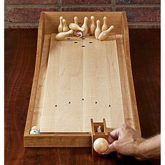 Few sports have the wide appeal of bowling. And now, you don't even need to rent shoes or lift a heavy ball to play. Make one of these game boards, and you can play with family and friends in the comfort of your home. Bowling, Woodworking Toys, Woodworking Projects, Woodworking Machinery, Wood Games, Wood Magazine, Backyard Games, Tabletop Games, Wood Toys