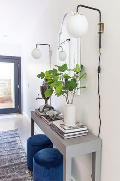 Modern entryway design with AllModern grey console table blue velvet stools and sconce lights on Thou Swell Modern Entryway, Entryway Decor, Gray Console Table, Velvet Stool, Entry Way Design, Sconce Lighting, Mid-century Modern, Modern Decor, Townhouse