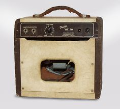 Fender Champion Model 600 Model Tube Guitar Amplifier (1951), made in Fullerton, California, serial # 3813, Cream and Brown fabric covering finish.  A wonderful example of the Fender Champ 600, the company's early student amp. These are not as loud or crunchy as later Champs, it remains fairly ci...