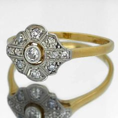 An antique diamond engagement ring in 14k yellow gold.