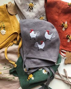 Handmade linen baby bonnets with hand embroidery. by MammaBearBabyBonnets Wool Embroidery, Christmas Embroidery, Simple Embroidery, Embroidery Stitches, Embroidered Bird, Embroidered Clothes, Flax Plant, Baby Dress Patterns, Wool Thread