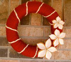 For Christmas. Yarn wrapped around styrofoam wreath, felt flowers.