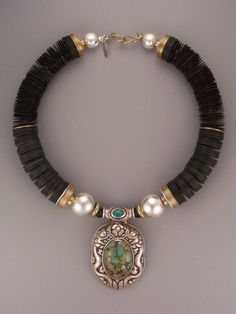 Africa black vulcanite...Nepal pendant (silver/turquoise)...Thailand fine silver...brass washers... teri@teripelio.com