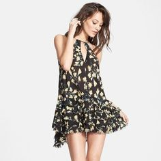 Free People Dress Gorgeous black dress with yellow flower prints, perfect for the spring and summer! Free People Dresses Midi