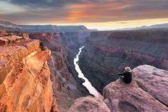 A hiker takes in the view at Toroweap Point on the North Rim of the Grand Canyon. Image by www.fischerfotografie.nl / Getty