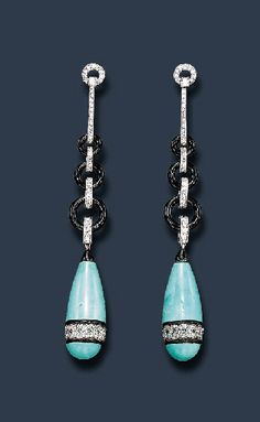 AN EXQUISITE PAIR OF ART DECO ENAMEL EAR PENDANTS Each set with a drop-shaped aqua colored enamelled pendant, enhanced by black enamelled and rose-cut diamond scroll motif trim, suspended by old mine, old European and single-cut diamond links alternating with black enamelled links, from a similarly-set geometric surmount, mounted in platinum and 18k gold, ca. 1925.