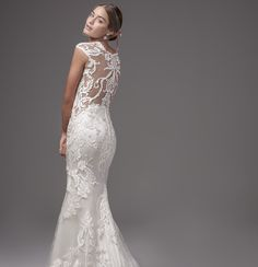 Striking laser-cut lace motifs cascade down this chic and sexy fit-and-flare  accenting the illusion side-cutouts, sweetheart neckline, and illusion cap-sleeves that glide into a statement illusion-back.  Dress is designed by #Sotteroand Midgley, @Maggie.Sottero, #laceweddingdress, #weddingdress, #bride