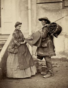 Tucked up over skirt(?) and apron, c 1857