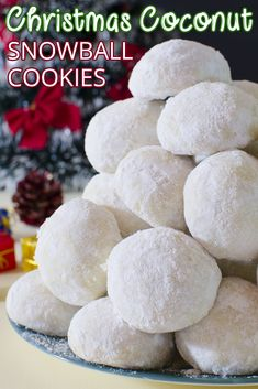 Christmas Coconut Snowball Cookies are melt-in-your-mouth, delicious coconut cookies rolled in powdered sugar. They will be perfect for your Christmas cookie tray! #christmas #cookies #coconut #snowball