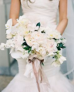 Light white bright bouquet with flowers tied with ribbon held by bride in mermaid wedding dress Wedding Reception Flowers, Wedding Flower Arrangements, Wedding Bouquets, Wedding Dresses, Floral Arrangements, White Bouquets, Wedding Bells, Wedding Ceremony, Chic Wedding