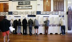 Australians flocked to vote in national elections Saturday with conservative leader Malcolm Turnbull appearing to have a slight edge..
