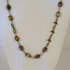 Check out this item in my Etsy shop https://www.etsy.com/listing/90035501/multicolored-agate-bronze-chain-necklace