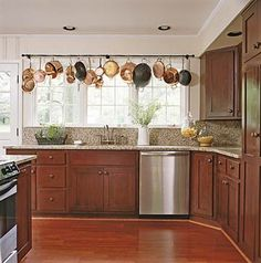 """Lots of kitchen organization ideas here, but I really like this """"valance"""" made from copper pots. #kitchen"""