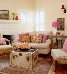 Adorable tiny space.  Love chests as coffee tables and of course the pink accents!