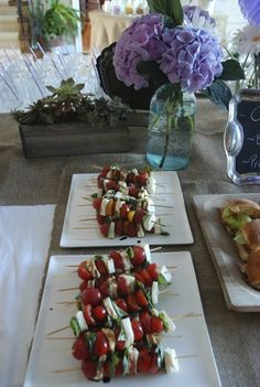 Succulents, hydrangeas, burlap and tomato and fresh mozza skewers for a rustic bridal shower