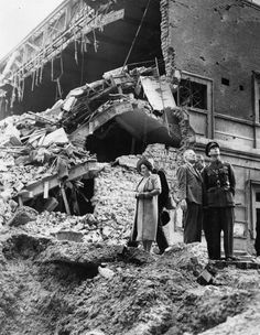 London, England, 1940, King George VI and Queen Elizabeth (later the Queen Mother) inspect the damage to a cinema building in Baker Street after it was destroyed by Nazi bombing in an air raid over the capital (Photo by Popperfoto/Getty Images)