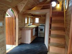 Pinafore Tiny House on Wheels by Zyl Vardos Photo-- Super unique craftsmanship! Love the stairs and closet!