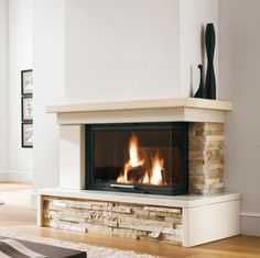 Fireplaces and stoves - Palazzetti Fireplaces and stoves - Palazzetti Cabin Fireplace, Fireplace Remodel, Living Room With Fireplace, Fireplace Design, New Living Room, Living Room Decor, Deco Tv, Modern Stone Fireplace, Modern Classic Interior