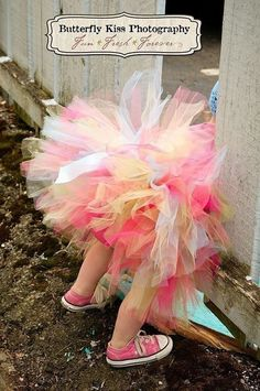 what girl does not like a good tutu? (with pink chucks to boot?)