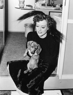 Joan Crawford with her dachshund on the set of The Women (1939).