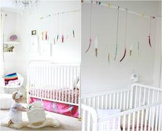 Mobile fürs Babyzimmer - bunt bemalte Federn hängen von einem Ast