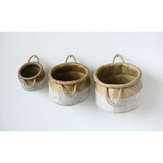 The Studios White and Natural Seagrass Basket - Set of 3 is designed with rolled tops and braided handles. Each basket is a different size, and. Rattan Basket, Seagrass Baskets, Woven Baskets, Belly Basket, Basket Shelves, Creative Co Op, Basket Decoration, White Beige, Storage Containers