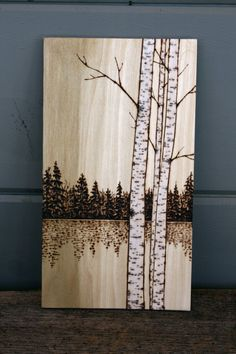 These beautiful birch trees have been burnt into a thin piece of poplar wood and finished with a touch of whitewash to enhance the birch trees