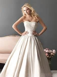 Allure 2618 Size 12 White $599  www.bellabrideshop.com 3028 Winghaven Blvd., O'Fallon, MO 63368 636-625-1330 info@bellabrideshop.com