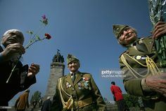A Bulgarian World War II veteran carries flowers at the monument of the Soviet Army in Sofia 09 May 2006 during celebrations of the WW II victory against Nazi Germany in Bulgaria.