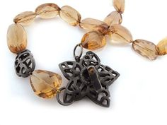 Photo: Oxidised silver clasp with faceted citrine beads. Commissioned and sold by Veronica Anderson Jewellers.