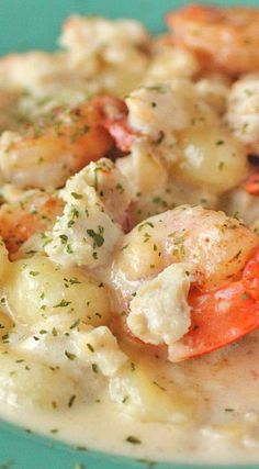 Seafood Gnocchi with White Wine Cream Sauce. Too bad it's vegetarian March. Pinning for future reference