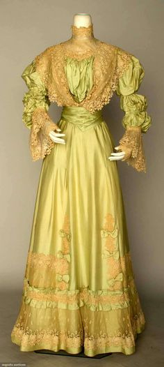 GREEN SILK TEA DRESS, c. 1898 2-piece mint green China silk, chemical lace flounce trim on bodice & skirt, silk chiffon waist, black velvet ribbon, white eyelet & diamante button trims. Front
