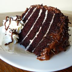 A heavenly Six Layer Chocolate Cake filled with layers of vanilla frosting and coated in creamy chocolate frosting.