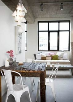 Love a rustic table mixed with modern...