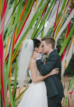ceremony backdrops:  ribbons (photo by the nichols)...ours in turquoise, yellow and white?