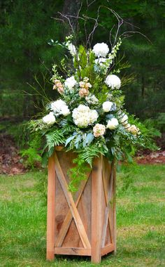 Large arrangement on box built by the bride's father.